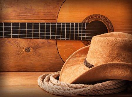 Photo pour Fond américain de musique country avec chapeau de cow-boy et lasso - image libre de droit