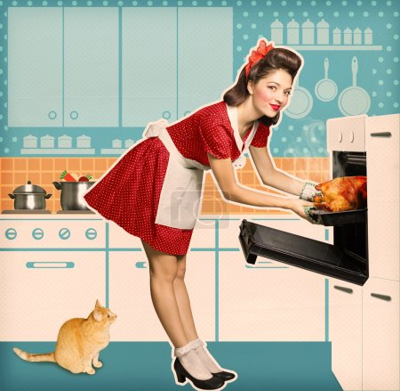 Young attractive housewife cooking in an oven.Retro kitchen room