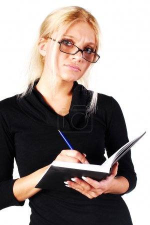 Secretary in glasses with notebook
