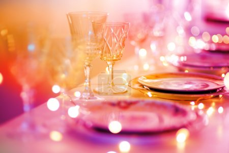 Photo for Table set for an event party or wedding reception in purple light - Royalty Free Image
