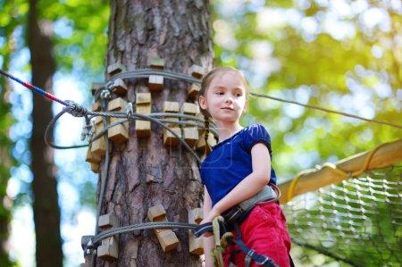 little girl enjoying  climbing