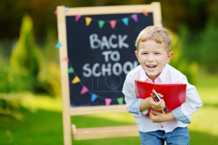 Photo for Cute little schoolboy feeling very excited about going back to school - Royalty Free Image