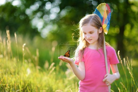 girl catching butterfly