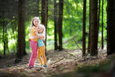 sisters hiking in forest