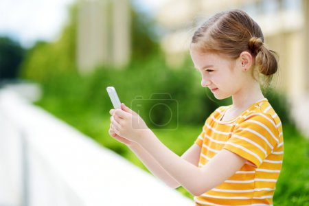 cute girl playing mobile game