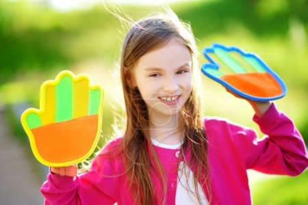 girl with velcro palm pads