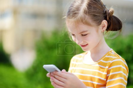 girl playing outdoor mobile game