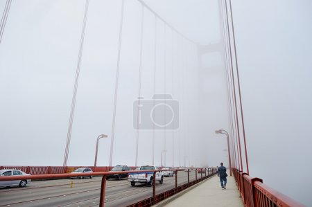 Photo for World famous Golden Gate Bridge covered by fog in San Francisco - Royalty Free Image