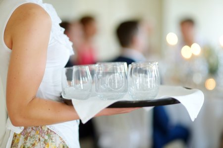 Waitress with empty glasses