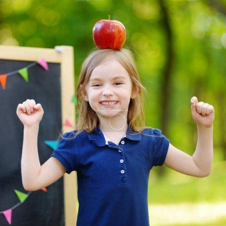 Little schoolgirl with apple