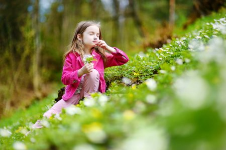 girl picking the first flowers