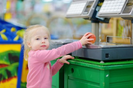 Cute little toddler girl shopping