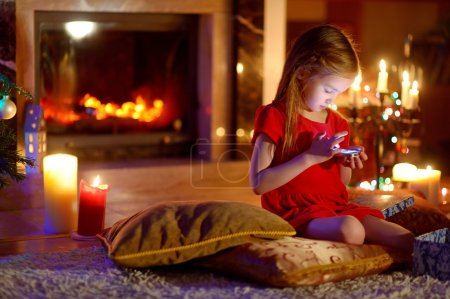 Little girl playing with her smart phone