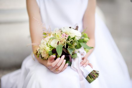 Bride holding a beautiful wedding bouquet