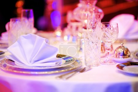 Photo for Beautiful Table set for an event party or wedding reception in purple light - Royalty Free Image