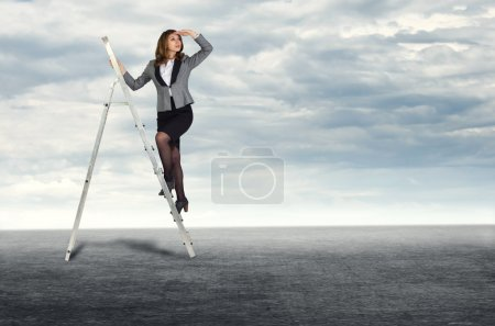 Businesswoman climbing the stairs