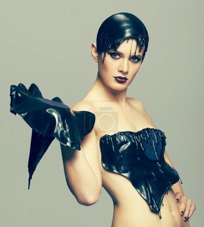Photo pour Femme en robe faite de disque de vinyle fondu avec disque dans les mains - image libre de droit