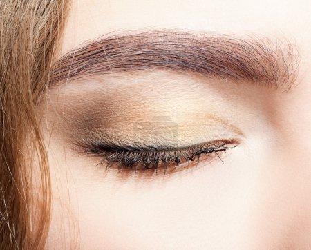 Closed female eye makeup