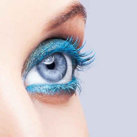 Close-up shot of female eye blue make-up