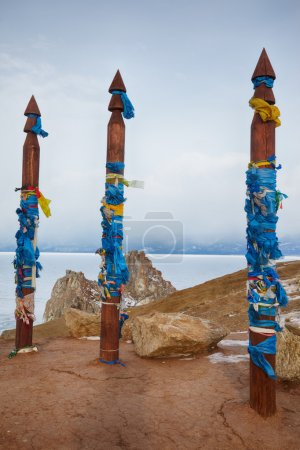 Wooden shaman totems with ribbons