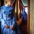 Young woman in blue vintage dress late 19th centur...