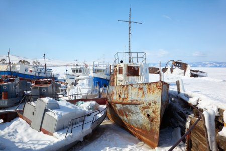 Old frozen ships in the port of Olkhon island on siberian lake B