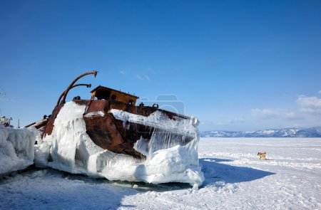 Old frozen ship on the bank of Olkhon island on lake Baikal