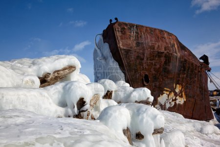 Old frozen ship on the bank of Olkhon island on siberian lake Ba