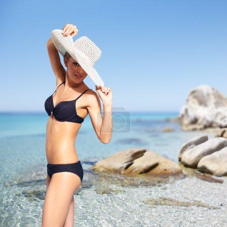 beautiful woman in bikini on sea background
