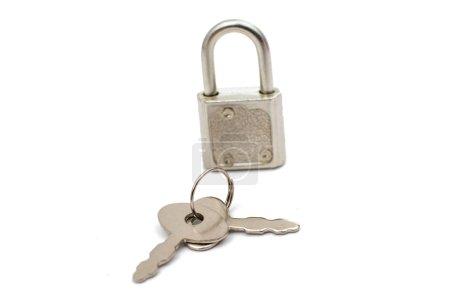 Metal padlock with keys on a ring