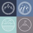Vector mountain logos and emblems in outline style...