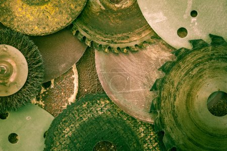 Old abrasive discs and hacksaw blade background.
