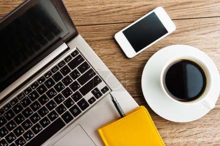 Laptop and mobile with coffee cup