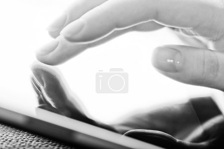 Fingers touching  tablet pc
