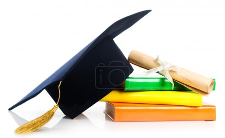 Mortarboard and graduation scroll on books