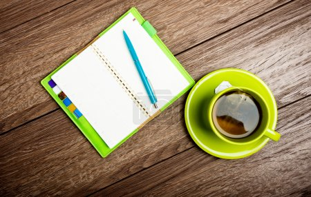 Cup of tea, pen and organizer