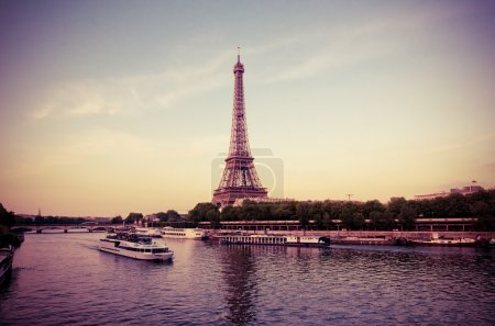 Eiffel Tower with boats in evening