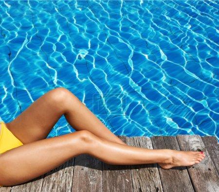Woman relaxing at pool