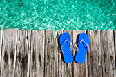 Blue slippers at jetty