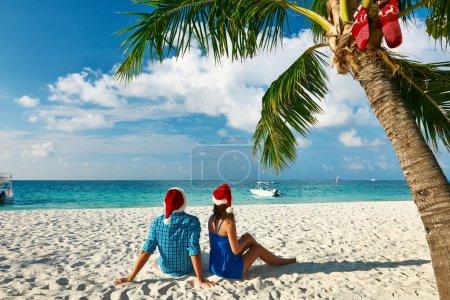 Couple on a beach at Christmas