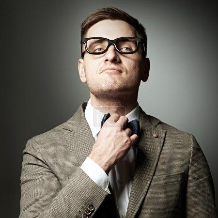 Confident nerd in eyeglasses