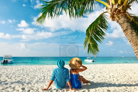Couple in blue clothes on beach