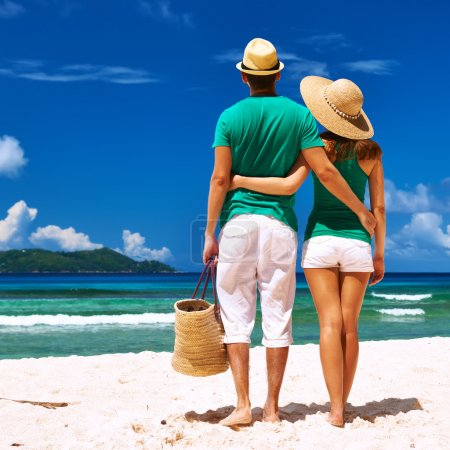 Photo for Couple relaxing on tropical beach at Seychelles, La Digue. - Royalty Free Image