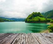 Beautiful emerald mountain lake in Switzerland