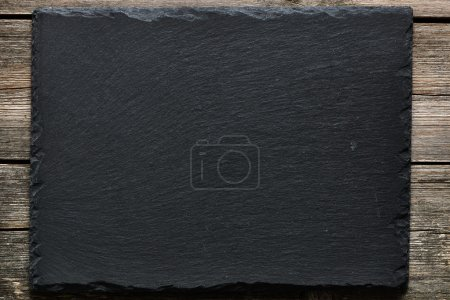 Slate on wooden  background