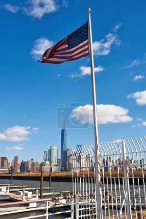 US American flag over Manhattan skyline