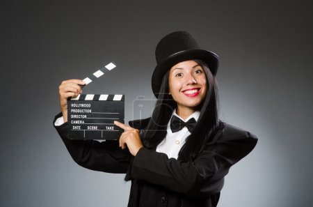 Woman with vintage hat and movie board