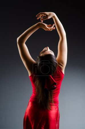 Photo for Woman dancing dances in red dress - Royalty Free Image