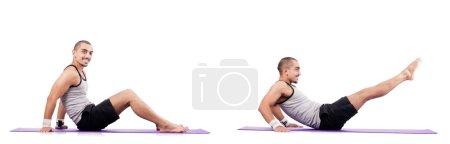 Photo pour Homme faisant des exercices sur blanc - image libre de droit