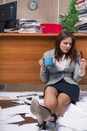 Photo for Businesswoman under stress working in the office - Royalty Free Image